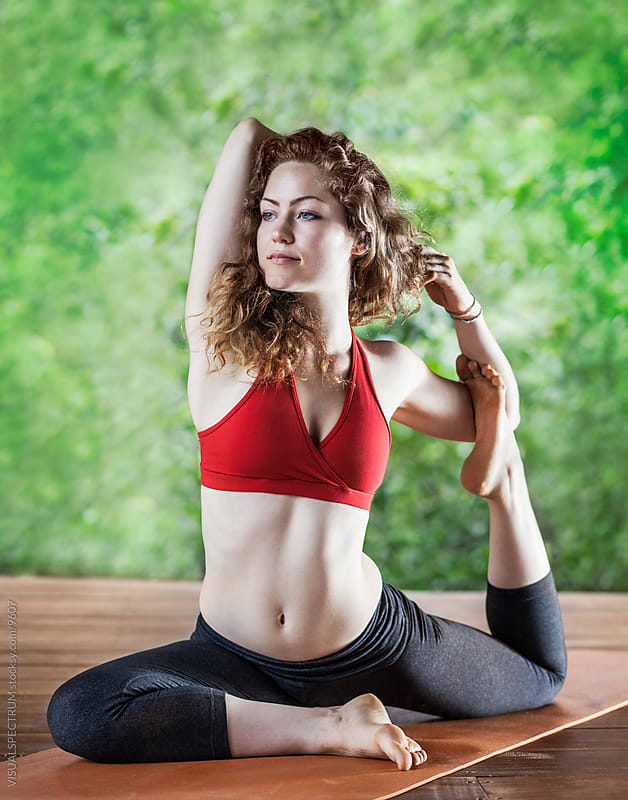 Young Woman Practising Yoga Asana by VISUALSPECTRUM for Stocksy United