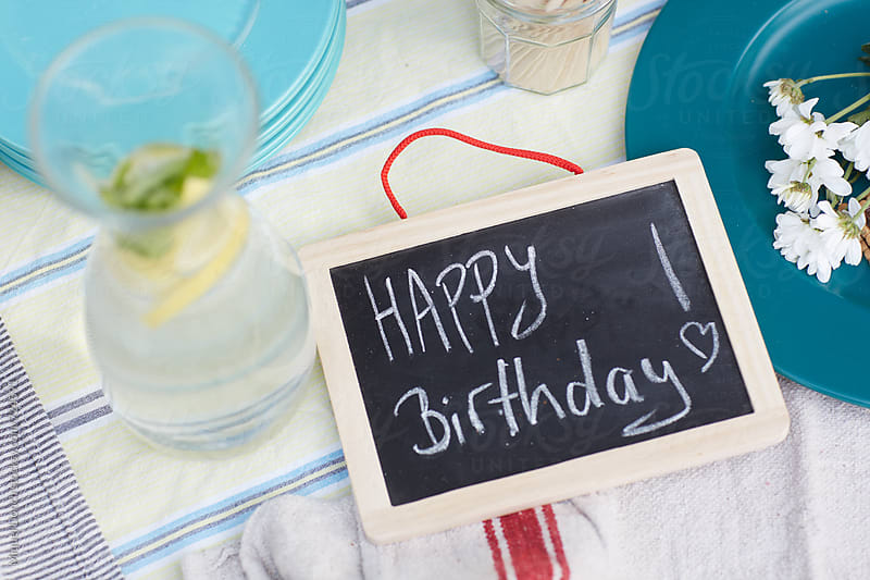Black board with the word happy birthday by Miquel Llonch for Stocksy United