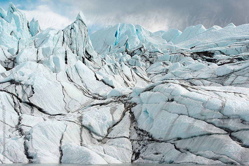 the face of a glacier by Tara Romasanta for Stocksy United