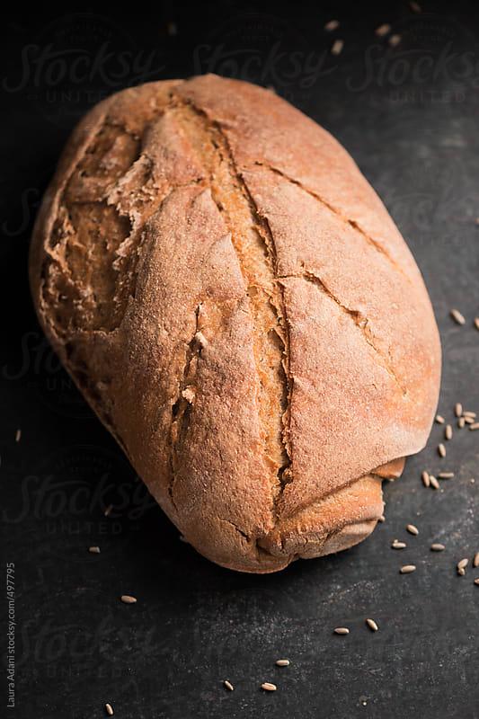 Sourdough rye bread by Laura Adani for Stocksy United