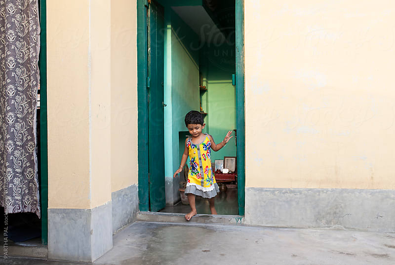 A little girl exits from a room by PARTHA PAL for Stocksy United
