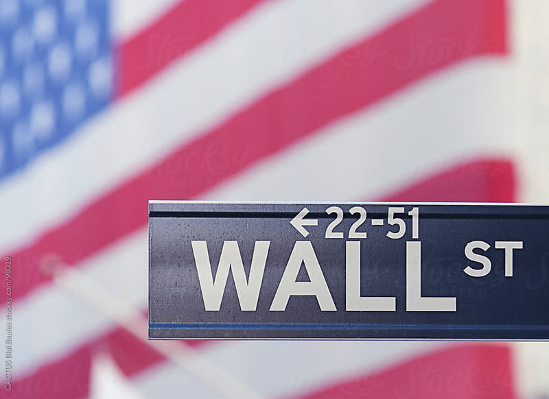 Wall Street sign with USA flag on background. by CACTUS Blai Baules for Stocksy United