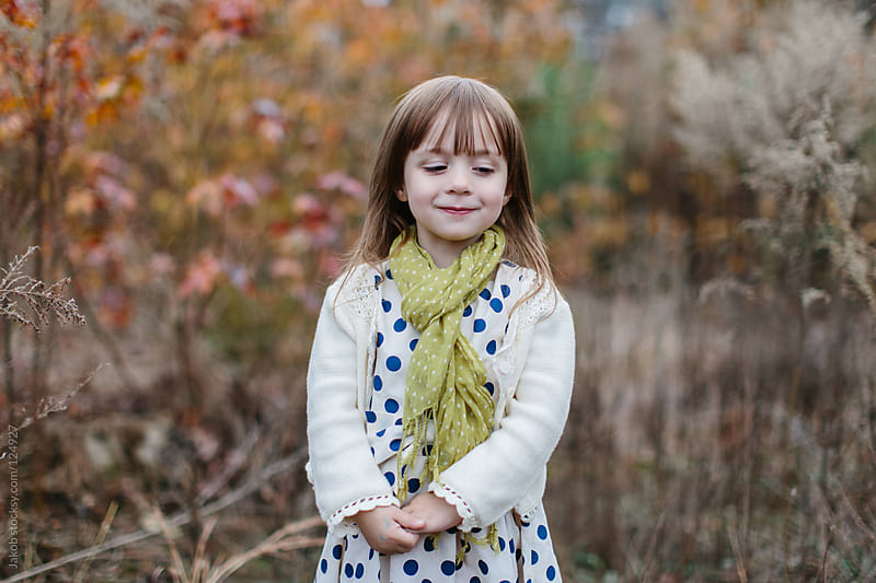 Adorable shy girl looking away from camera by Jakob for Stocksy United