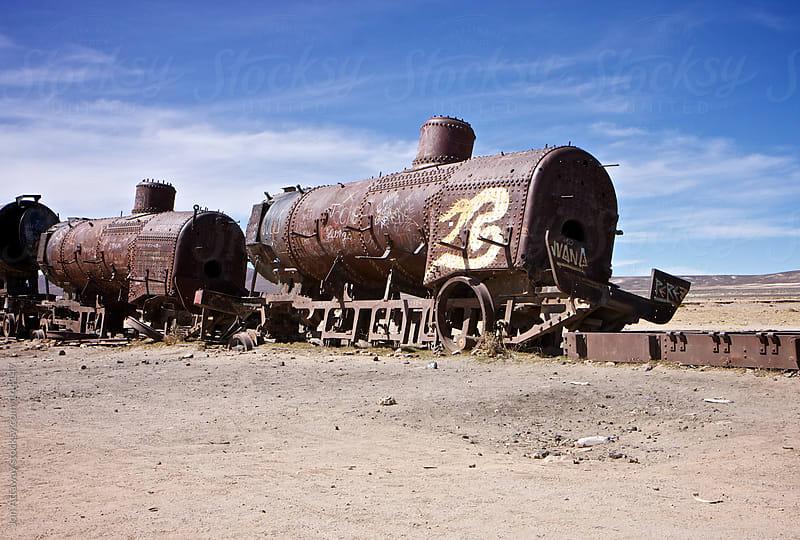 Train graveyard by Jon Attaway for Stocksy United