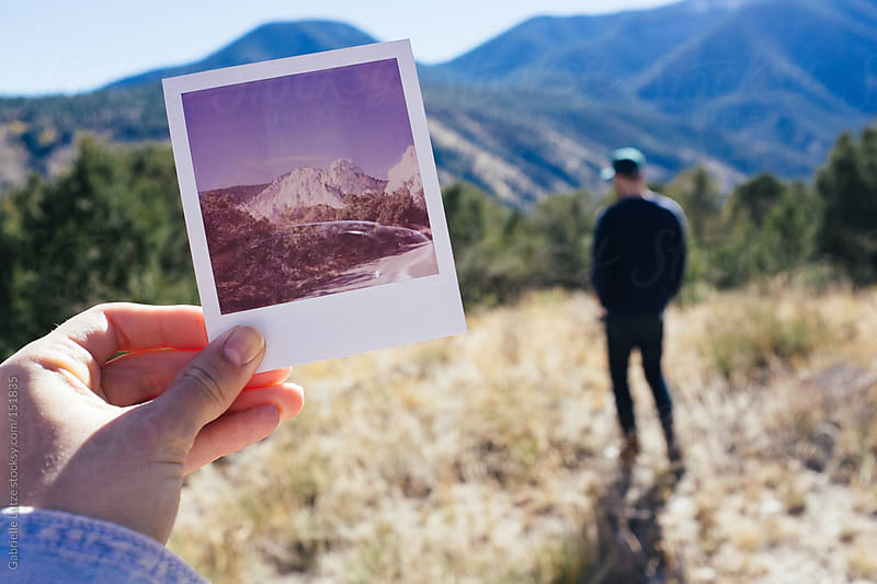 Holding a Polaroid of a Mountain on a Sunny Day by Gabrielle Lutze for Stocksy United