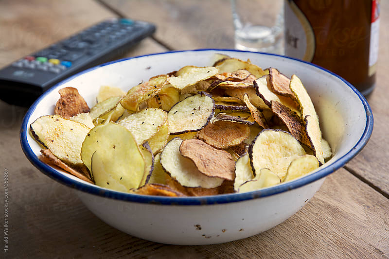 Home made potato chips by Harald Walker for Stocksy United