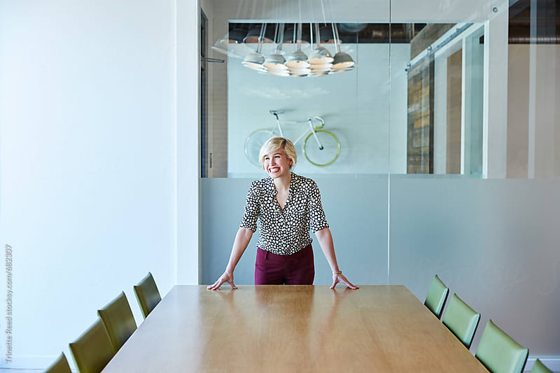 Portrait of millennial businesswoman at tech start up office  by Trinette Reed for Stocksy United