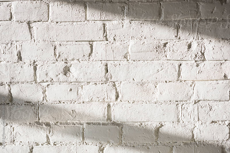 White brick wall indoors by Danil Nevsky for Stocksy United