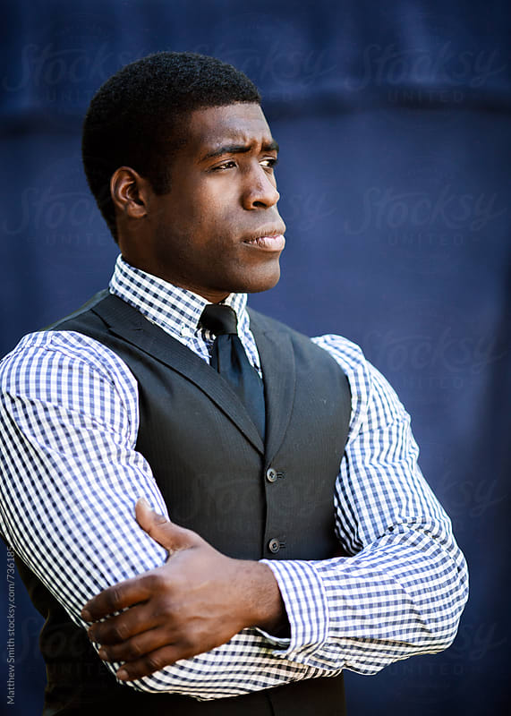 Serious African American Looking Away From The Camera by Matthew Smith for Stocksy United