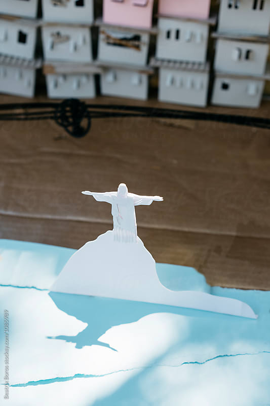 Christ the redeemer on Corcovado made of cardboard illuminated by the Sun by Beatrix Boros for Stocksy United