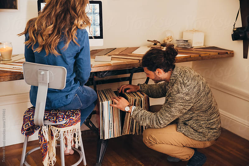 Couple working in home office by Trinette Reed for Stocksy United