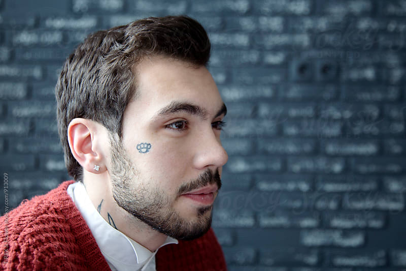 Young bearded businessman with tattoo by Danil Nevsky for Stocksy United