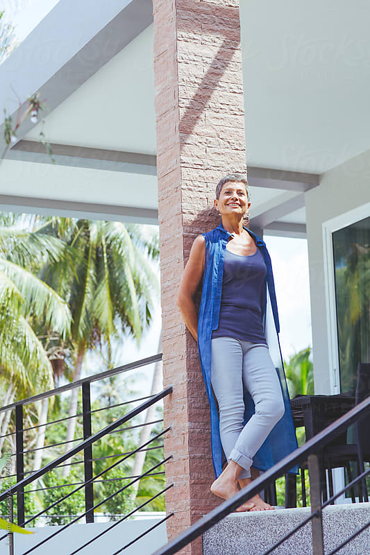Senior Woman Standing Outdoors by Lumina for Stocksy United