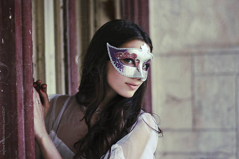 Beautiful girl wearing a mask by Jovana Rikalo for Stocksy United