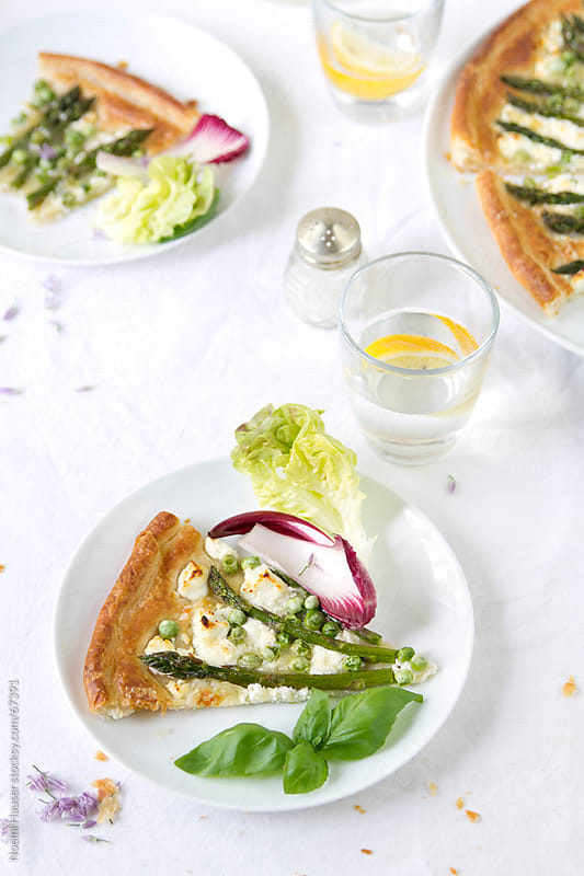 Slice of asparagus and pea tart by Noemi Hauser for Stocksy United