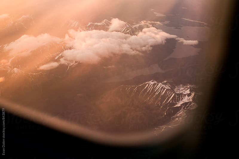 Alaskan Mountains From Airplane Window by Evan Dalen for Stocksy United