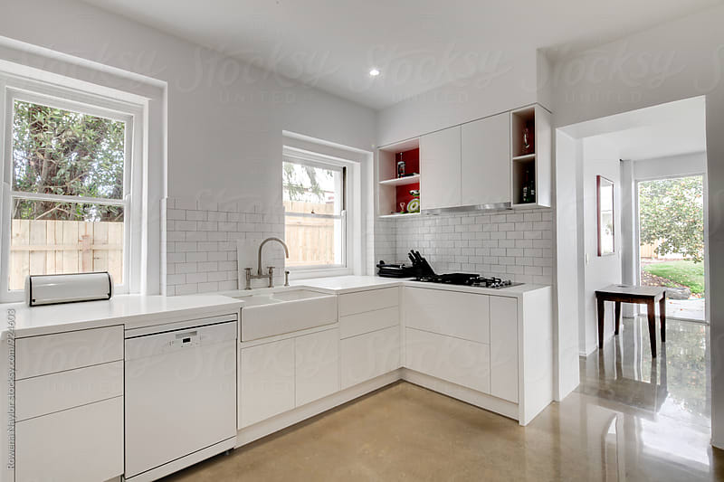 Clean white kitchen by Rowena Naylor for Stocksy United