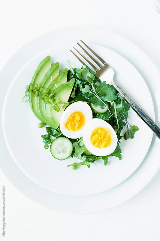 Fresh green salad with boiled egg by Ellie Baygulov for Stocksy United