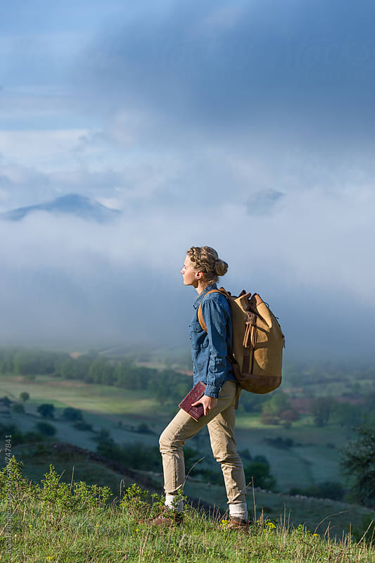 Young woman hiking in the early morning by RG&B Images for Stocksy United