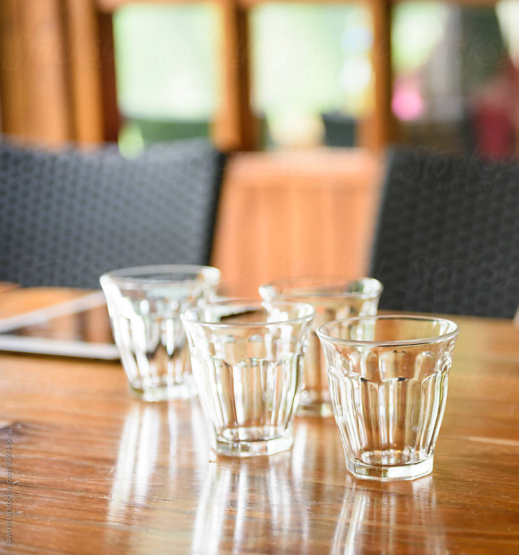 Empty glasses on dining table in restaurant by Lawren Lu for Stocksy United