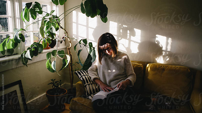 Christen in window light by Kim Jay for Stocksy United