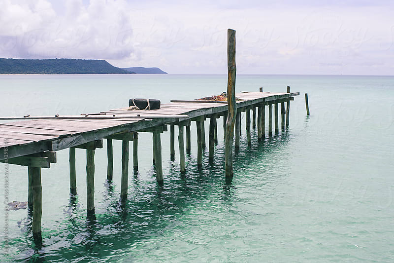 Wooden dock on turquoise water sea on tropical island by Alejandro Moreno de Carlos for Stocksy United