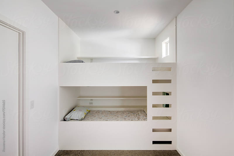 Built in bunk beds in kids room by Rowena Naylor for Stocksy United