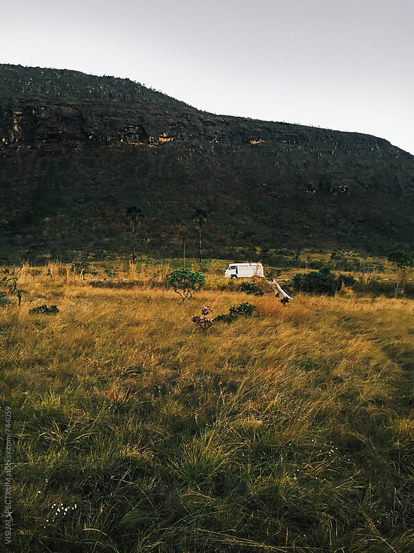 Old-Fashioned White Camper Van Parked in Wild Grassland by VISUALSPECTRUM for Stocksy United