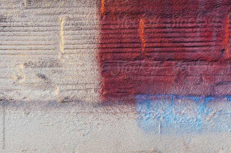 Paint covering concrete and brick wall, close up by Paul Edmondson for Stocksy United