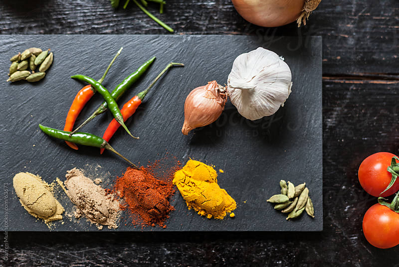 Herbs and spices on a table. by Darren Muir for Stocksy United