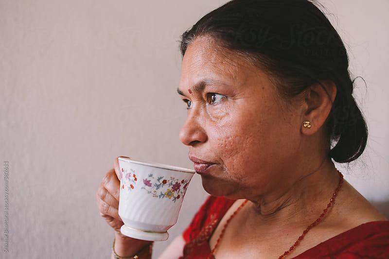 Middle aged South Asian woman having tea. by Shikhar Bhattarai for Stocksy United