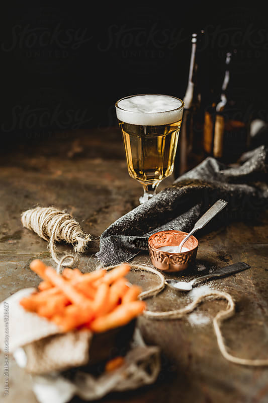 Beer with snacks by Tatjana Ristanic for Stocksy United