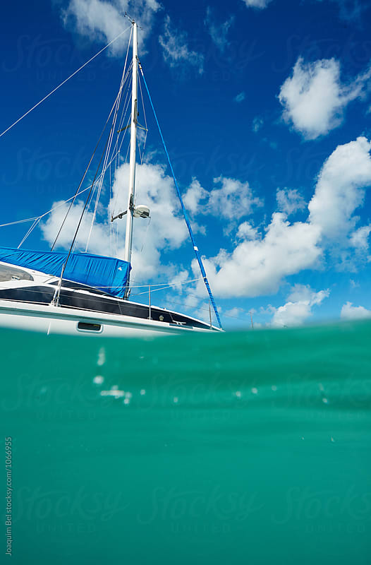 Catamaran view from the water by Joaquim Bel for Stocksy United