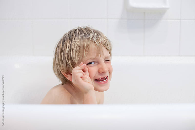 Silly boy in the bath by Carleton Photography for Stocksy United