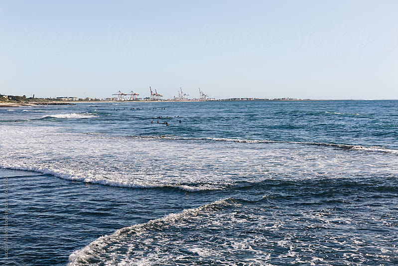 Distant surfers at Cottesloe beach, Western Australia by Jacqui Miller for Stocksy United