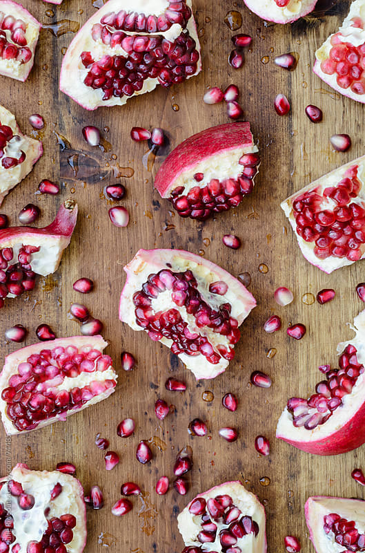 Pomegranate Pieces by Julie Rideout for Stocksy United