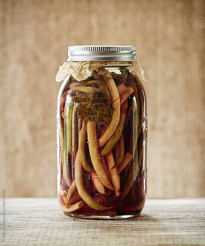 Still life of fermented pickled yellow and green beans in mason jar by Trinette Reed for Stocksy United