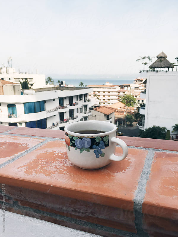 Coffee cup on terrace of apartment in Old Town, Puerto Vallarta, Mexico by Jared Harrell for Stocksy United
