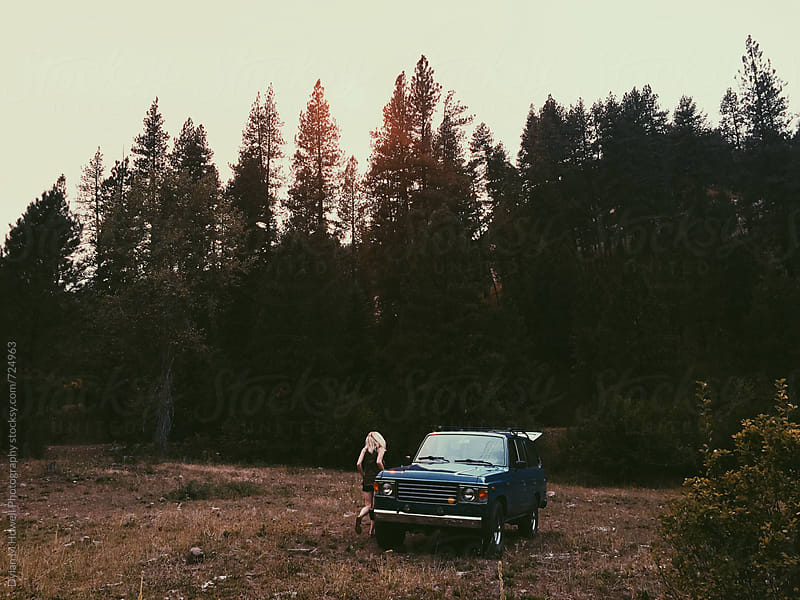 Driving into the forest.  by Dylan M Howell Photography for Stocksy United