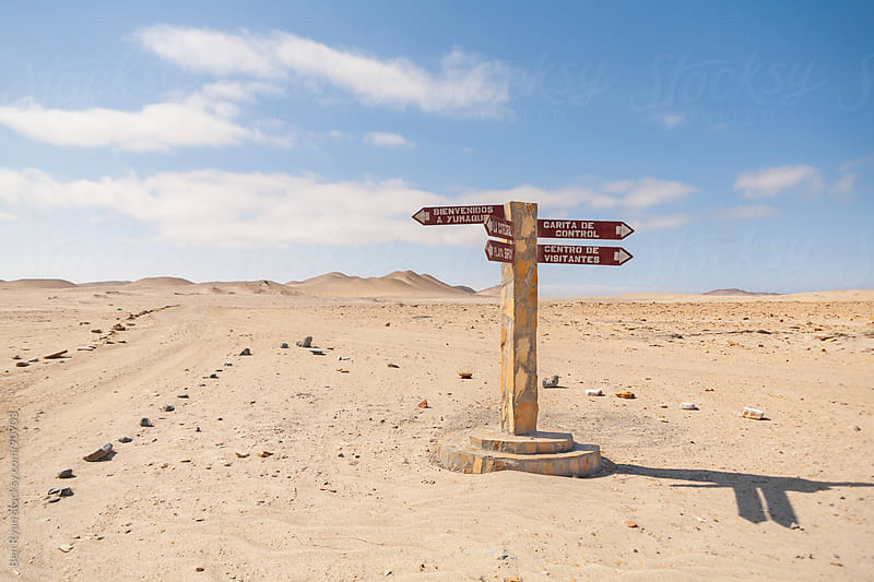 Signpost on desert tracks by Ben Ryan for Stocksy United