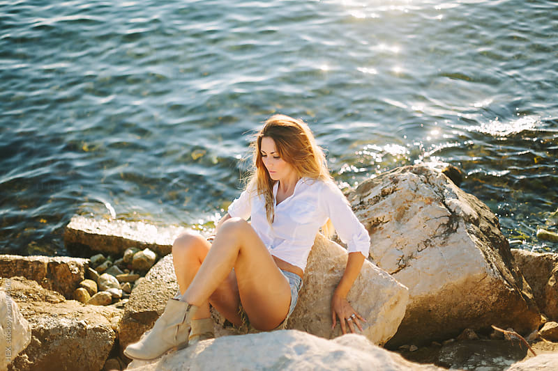 Sexy Beautiful Woman Sitting On the Sea Rocks by HEX. for Stocksy United