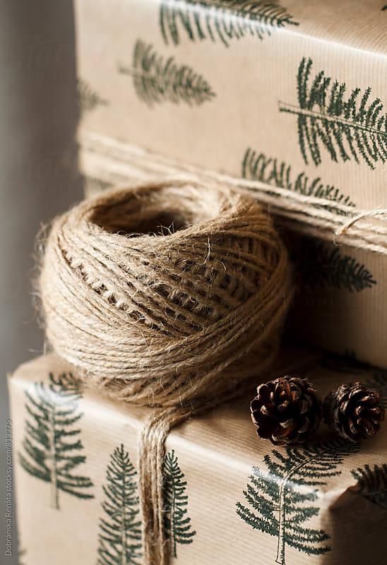 Packing Christmas present by Dobránska Renáta for Stocksy United