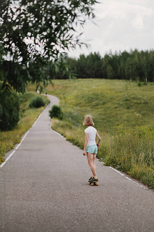 Casual girl riding skate on nature  by Sergey Filimonov for Stocksy United