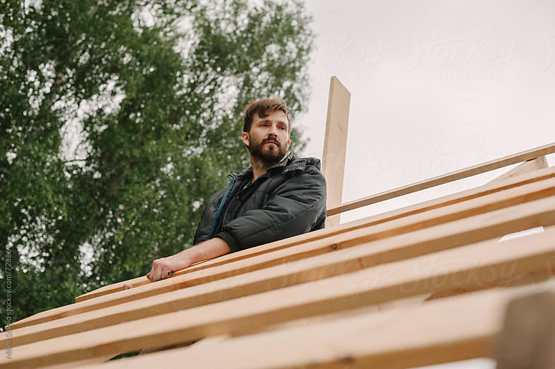 Man building wooden house by Milles Studio for Stocksy United