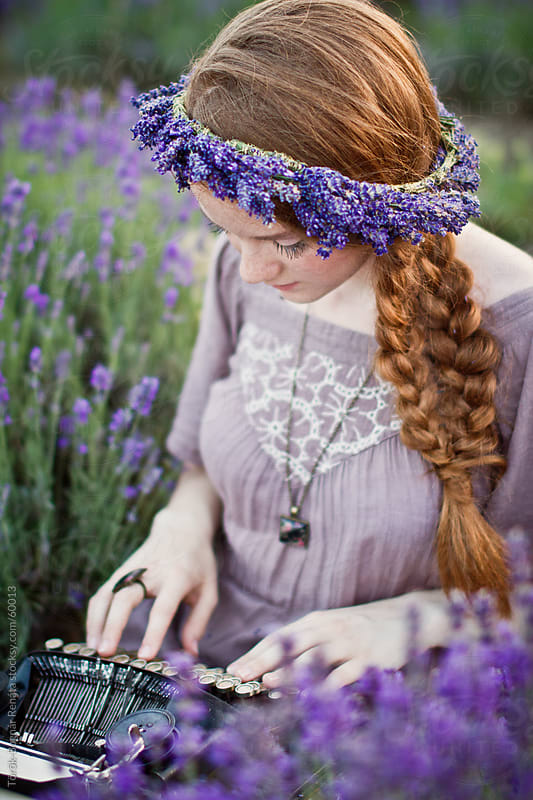Beautiful redhaid young woman in the lavender field with a vintage typewriter by Török-Bognár Renáta for Stocksy United