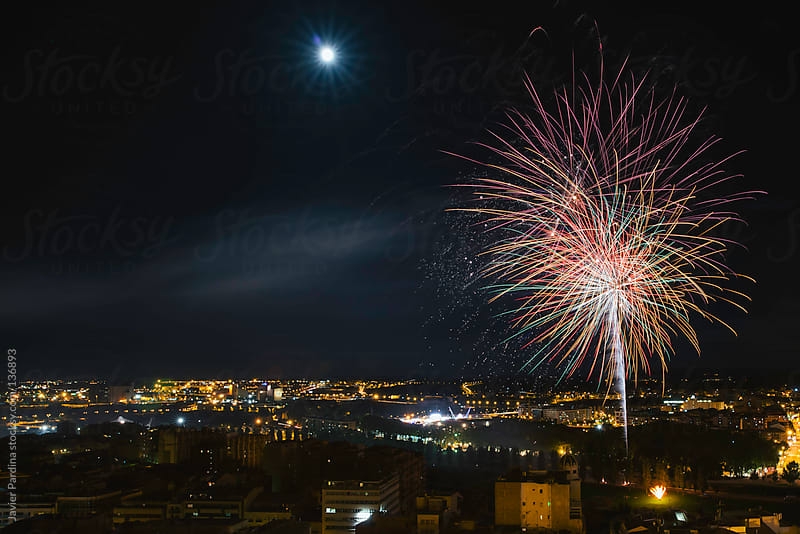 Fireworks on the city by Javier Pardina for Stocksy United