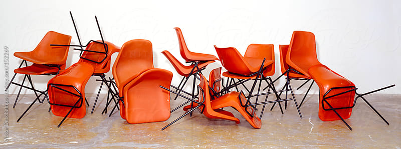 Messy Pile Of Orange Chairs (Chair Orgy) by Victor Deschamps for Stocksy United