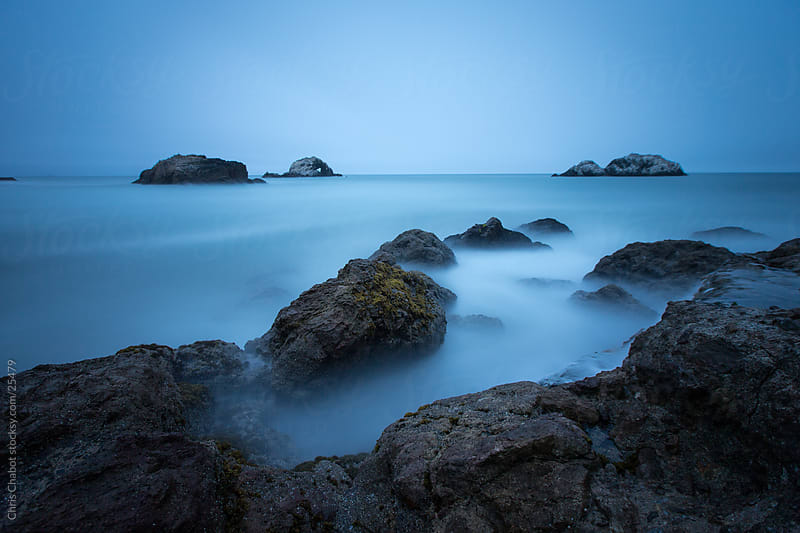 Long exposure of the ocean crashing on the rocks by Chris Chabot for Stocksy United