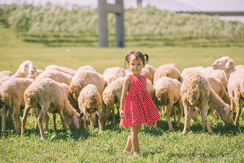 Baby girl on grassland by Maa Hoo for Stocksy United