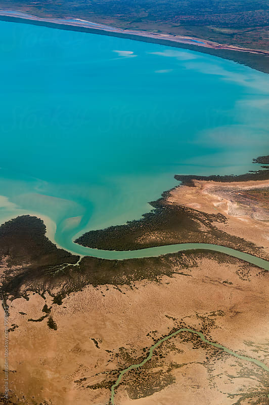 Aerial view of estuary and tributaries in the far north Western Australia by Angela Lumsden for Stocksy United